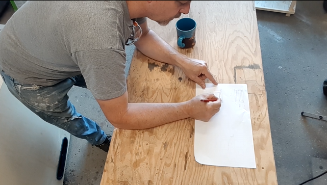 Picture of Paul sketching the coffee table