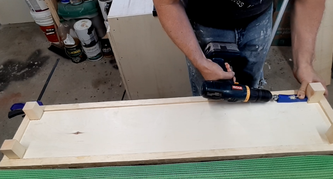 Attaching the bottom shelf to the legs