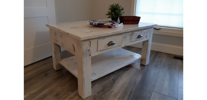 Completed antique white coffee table with all hardware attached