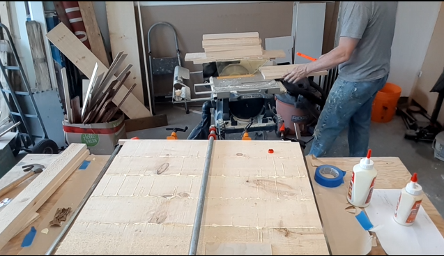 Paul cutting boards to width and gluing boards together