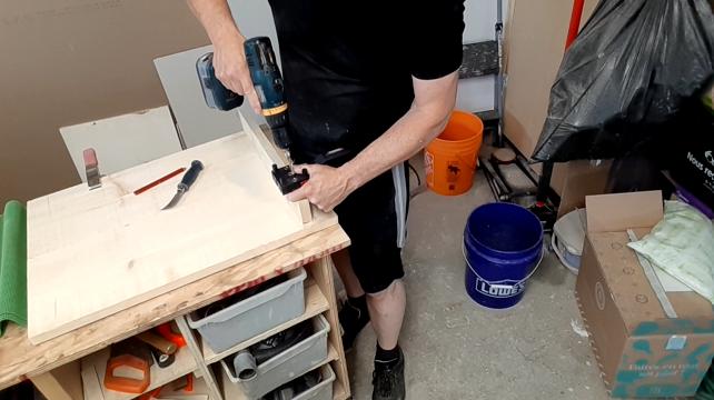 Paul using a dowel jig for extra strength