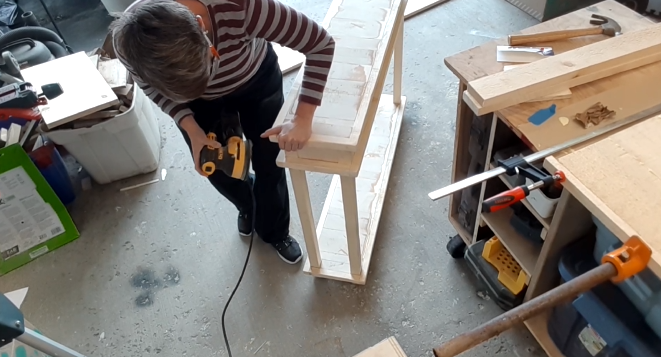 Sanding the hallway table to prep for homemade chalk paint