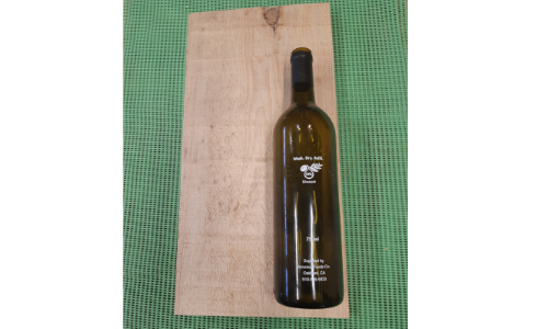 Scrap wood and empty bottle for sizing