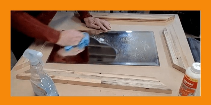 Cleaning the mirror before frame glue up